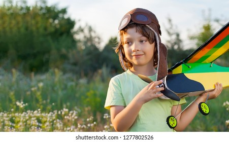 happy children with airplan toy outdoors (airplane is hand made not copyright)