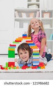 Happy children among the blocks - focus on the boy