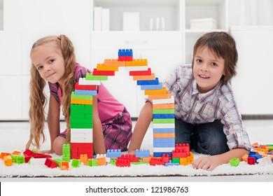 Happy children among of colorful blocks