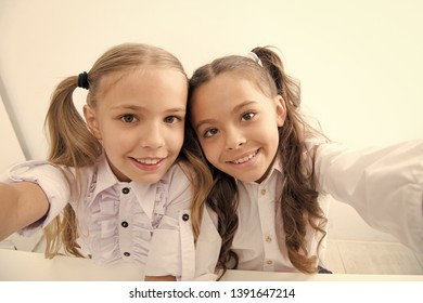 happy children back to school and making selfie. selfie of happy children in school uniform. cheerful students. pretty little girls. school day of little girls