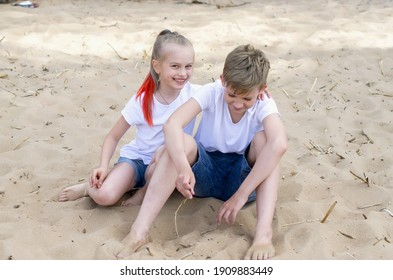 Happy children boy and girl on the beach in summer. Brother and sister fun siblings on the sand. Children friends