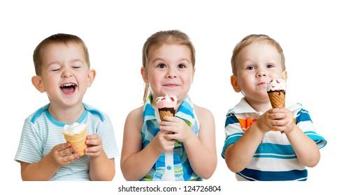happy children boy and girls eating ice cream in studio isolated