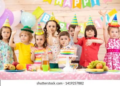 Happy Children Boys And Girls Celebrating Birthday Holiday