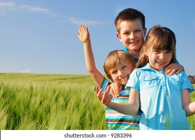 Happy children in cereal field