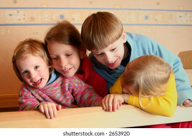 Happy children in child's room on a bunk-beds