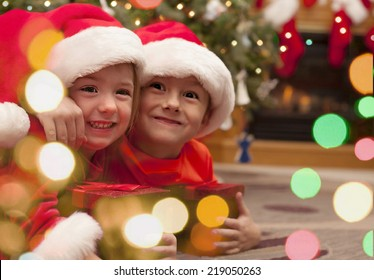 Happy children with Christmas gift