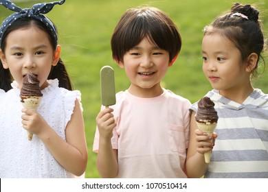 Happy children eat popsicles