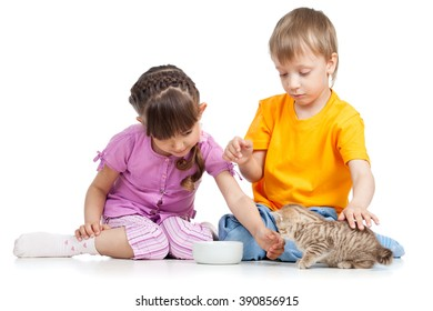 happy children feeding cat kitten