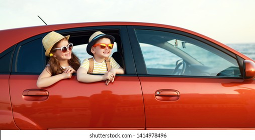 happy children girl and boy goes to summer travel trip in the car