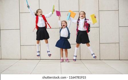 Happy children girls girlfriend schoolgirl student elementary school