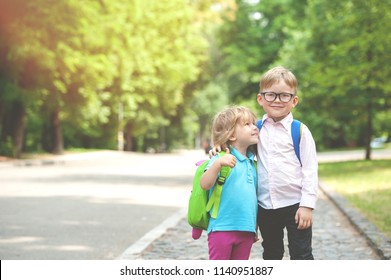 Happy children go back to school. Pupil of primary school go study with backpack outdoors. Kids go hand in hand. Beginning of lessons. First day of fall. Boy and girl from elementary student.