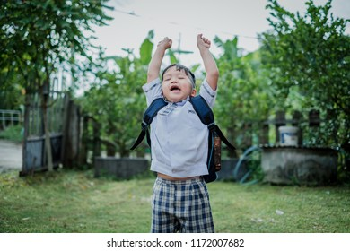 Happy children go back to school.Asian smiling boy jumping with two hands up  going to school for the first time.