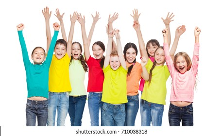 Happy children with hands up. Smiling group teens