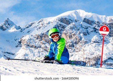 Happy children with helmet and goggles on the ski slopes