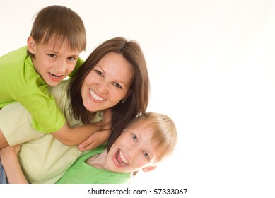 happy children hugging their mom on the wite