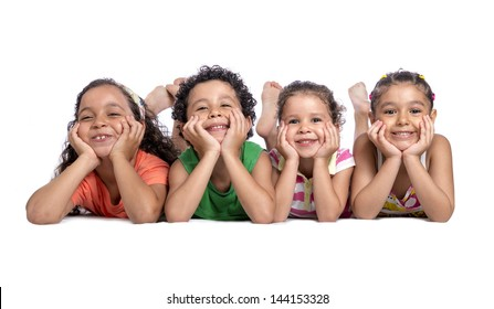 Happy Children Laying on the Floor Posing for Photo