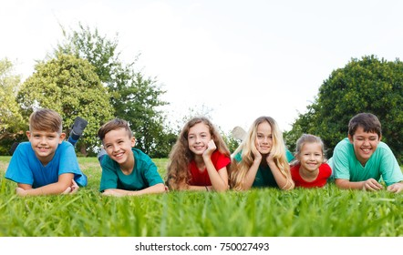 Happy children lying at park