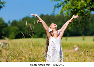 Happy children in a meadow in summer