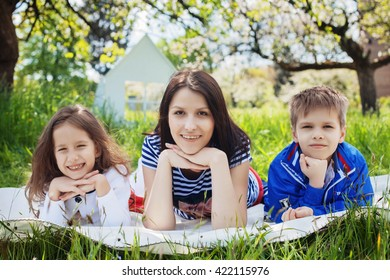 happy children with mother on a picnic