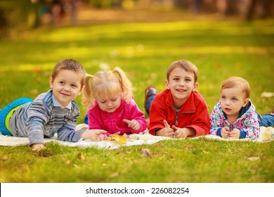 happy children in nature. reading a book outdoors lying on the grass