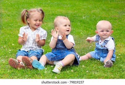 Happy children on green meadow.