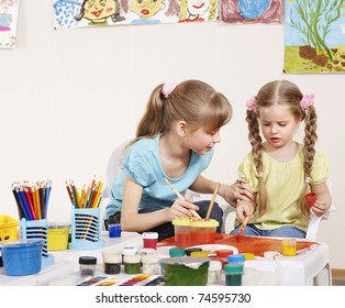 Happy children painting in preschool.
