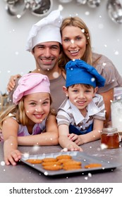 Happy children and parents eating biscuits with snow falling