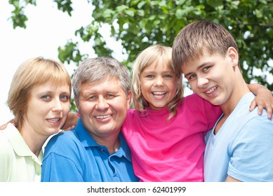 happy children with parents in the summer park