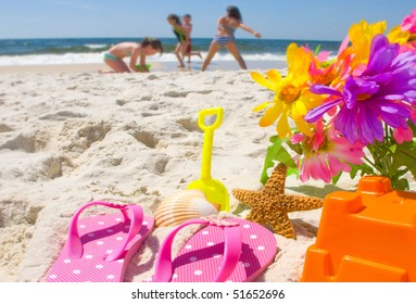 Happy children at play on the beach