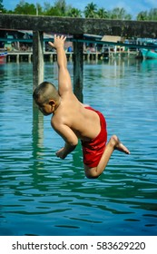 happy of children play springboard
