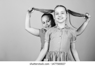 Happy children play together. Having sister is always fun. Best friends forever. Happy childhood. Girls sisters having fun together. Adorable sisters smiling faces. Family love. Sisterhood concept.