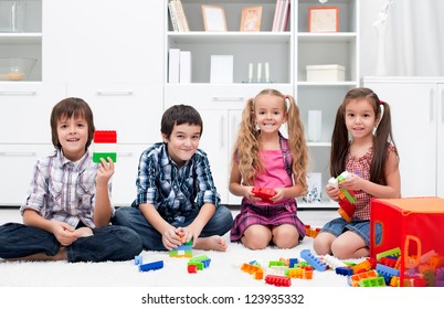 Happy children playing with blocks