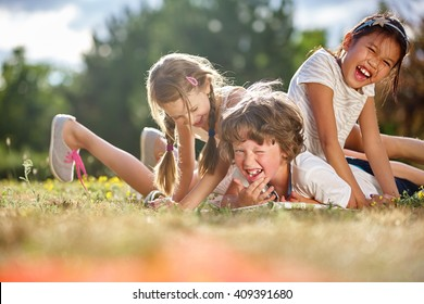 Happy children playing and having fun in summer