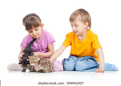 happy children playing with kitten