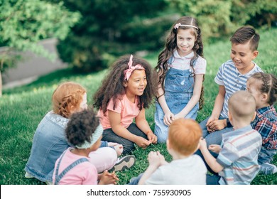 Happy children playing in the Park in the summer. Multicultural group. the concept of childhood, friendship and intercultural communication.
