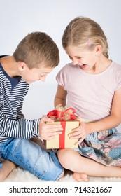 Happy children with present