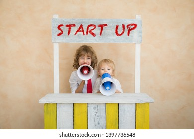 Happy children pretend to be businessmen. Funny kids playing at home. Education, start up and business idea concept