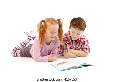 Happy children reading a book isolated on white background