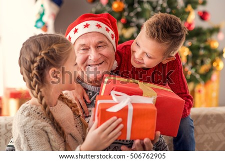 Happy Children Receiving Christmas Gifts Grandfather Stock Photo ...