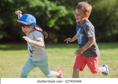 happy children running around outside playing catch-up concept.