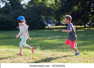 happy children running around outside  playing catch-up concept