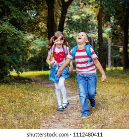 Happy children are running with backpacks from school. Square. The concept is back to school.