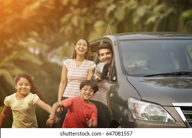 Happy children running from car