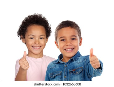 Happy children saying Ok with their thumbs isolated on a white background