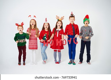 Happy children singing christmassy carols