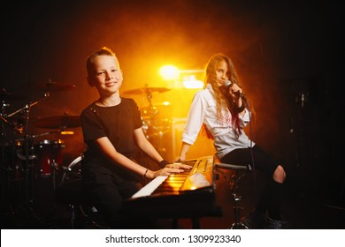happy children singing and playing music in recording studio