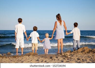 HAppy children are standing on beach, outdoor
