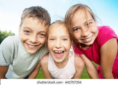 Happy children at summer. Girl and boy outdoors