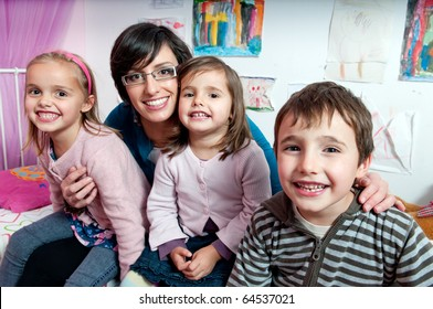 Happy children with their mother