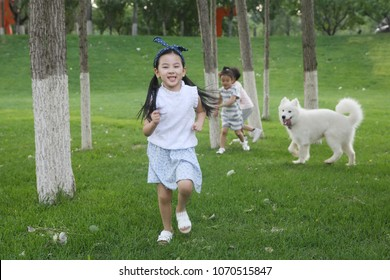 The happy children were playing outside